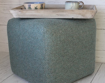 Cube upholstered in blue/green parquet wool.