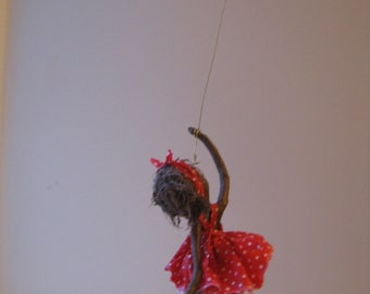 Girl with Red Balloon. Mixed media sculpture. Available