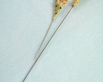 Set of 2 rhinestone studded hatpins; 1 bakelite, 1 celluloid