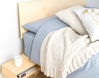 Floating bed with fold out bedside