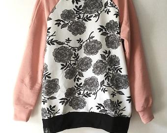 white and black floral raglan sweatshirt