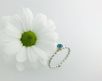 Stacker ring in Gold & Silver with Blue topaz