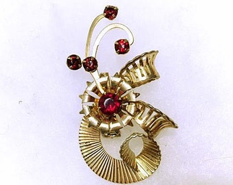 Vintage 1950s Atomic Brooch Pin 50s Ruby Red Rhinestone Shooting Stars Three-Dimensional Curved Form Scrolled Spiral Stylized Leaves Flower