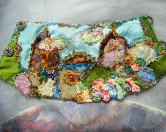 state of love and trust - a delicate hand embroidered collage wrist cuff in spring pastel colors