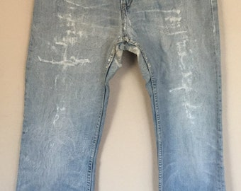 Incredible Vintage Patched and Stitched Levis 507 Flares
