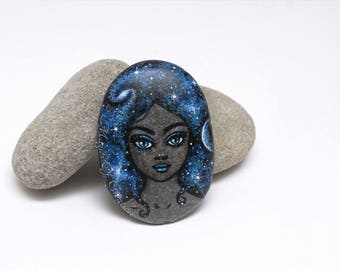 Fantasy spatial painted stone paperweight. Universe girl hand painted on a river stone as a unique paper weight! Gift idea for space lovers!