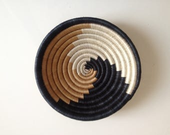African woven basket / craft cutting to ethnic patterns