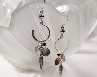 Hand hammered sterling silver wire hooks earrings with tibetan silver feathers, abalone shell charms and Czech glass beads