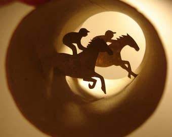 Roller Racing - Horse racing cut out paper sculpture inside of cardbord roll