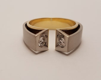 Two tone ring made of white gold and yellow gold with diamonds. Artistic piece of jewelry by Cober.