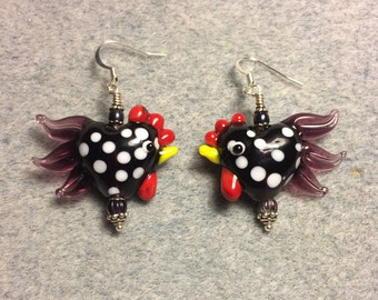 Black with white spots and purple tails lampwork heart shaped rooster bead earrings adorned with purple Czech glass beads.