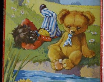 Puzzle - Toy bear and doll in the grass