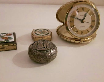 Vintage pill boxes and shell clock