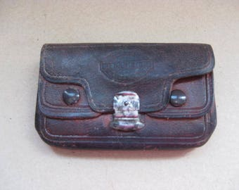 Beautiful vintage French brown leather purse with 4 pockets.