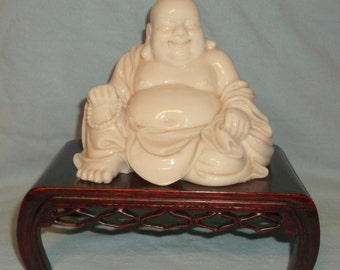 Porcelain Ivory Happy Sitting Buddha on Pedestal Lumbini Tags