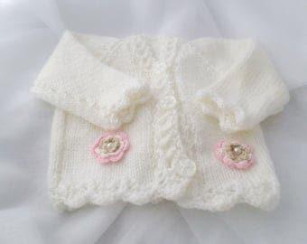 Hand knitted white baby girl cardigan