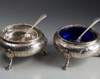 Two English Silver Salt Cellars with Glass and Silver Spoons
