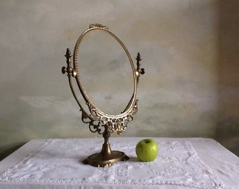 Vintage French oval frame. Free standing brass oval frame. Pivoting oval frame.