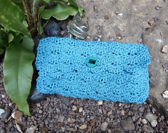 blue crocheted clutch bag with green lining