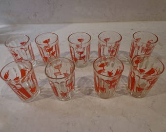 9 matching 1950's vintage shot glasses in retro red graphic design