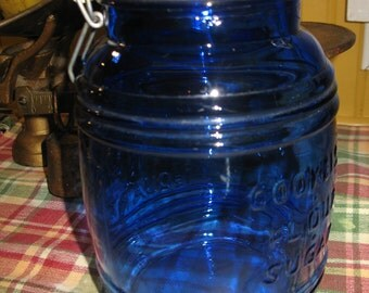 Cobalt blue jar (cracker barrel style) of 1.5 q.t cookie, sugar, flour.