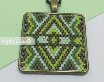 Green ethnic motif pendant