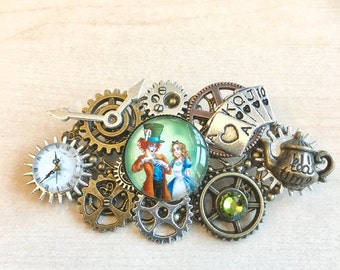 Alice in wonderland steampunk brooch with clockwork, watch dials, cogs, gears and charms