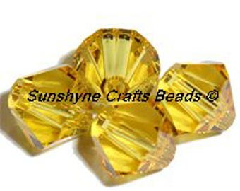 Swarovski Crystal Beads 5301/5328 LIGHT TOPAZ Xilion Faceted Bicone Beads - Sizes 4mm & 6mm available