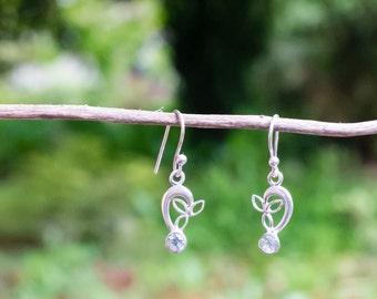 Sterling silver and blue topaz hook earrings