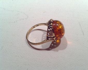 "Gold ring 333, ""Amber""."