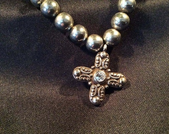 Silver ball bracelet with Cross!! Cross has crystals on both sides that sparkle with movement!! Beautiful must have!!