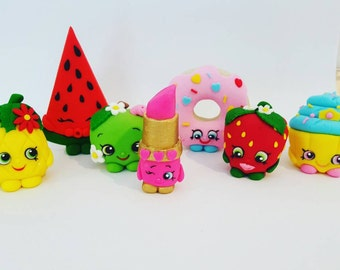 7 x Shopkins cake toppers plus name plaque