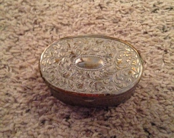 Beautiful silver small jewelry holder lined in red felt