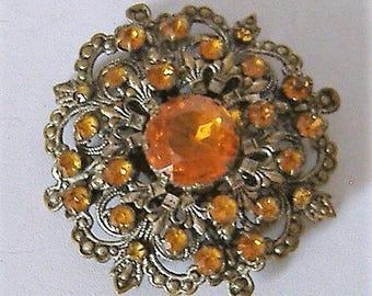 ART DECO PRESSED metal brooch orange/amber stones