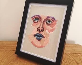 Framed face embroidery art