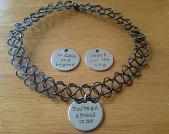 To infinity and beyond/ you've got a friend in me/ reach for the sky choker necklace