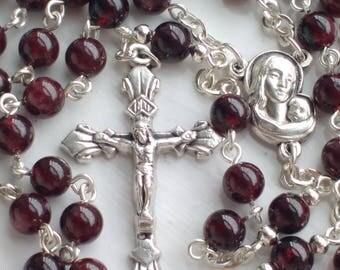 Garnet Rosary in Silver Finish.