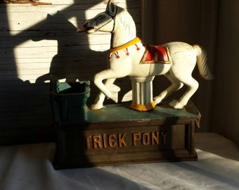 Vintage 50's or 60's Trick Pony  Cast Iron Bank.  This is a repro in Like New Condition. A great gift idea. Teach savings, responsibility