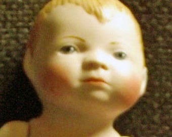 Small antique repro baby doll, approx. 12.5 cm (58)