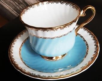 Sutherland H M Tea Cup and saucer, Vintage, vintage  tea cups, England, Blue, gold trim