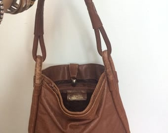 vintage, brown leather shoulder bag, well loved, well used, scuffed bag, made in Uruguay, for Gabay Vancouver, gorgeous old leather bag