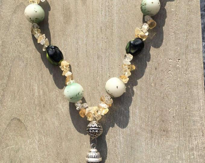 Elegant Citrine chip necklace with green beads and a silver chain tassel