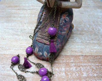 Handmade long necklace with tassel and purple ceramic beads