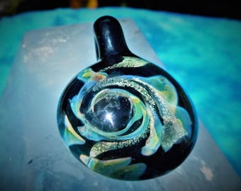 heady glass pendant, gold dichroic glass wave, trippy glass pendant, blown glass necklace. very bright flowing dichro, spacey background.