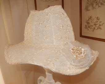 original Lampshade-shaped wide-brimmed hat adorned with a flower of ivory chiffon lace