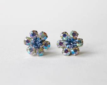 Vintage aurora borealis clip on flower earrings. Diamanté crystal AB flower clip on earrings. Blue AB earrings. Blue flower rainbow earrings
