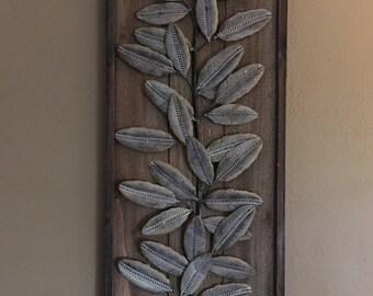 Tin leaf and wood wall art