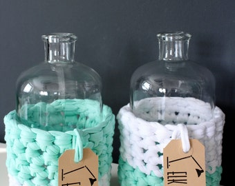 Set of vases with crochet covers