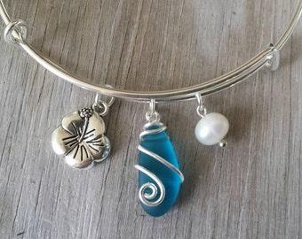 Handmade in Hawaii, wire wrapped teal blue sea glass bracelet, Sea glass jewelry,Hibiscus charm, Fresh water pearl, Hawaiian jewelry.
