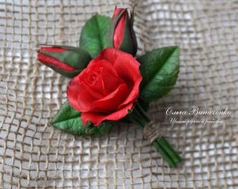 Brooch with dark red rose